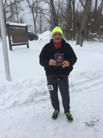 Victor after completing the January 1, 2018 5K at Presque Isle State Park in Erie. The bitter cold, wind and snow did not stop Victor.