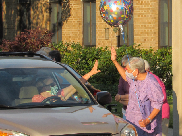 Sister Stephanie high-fives with Oblate Sheila McLaughlin.