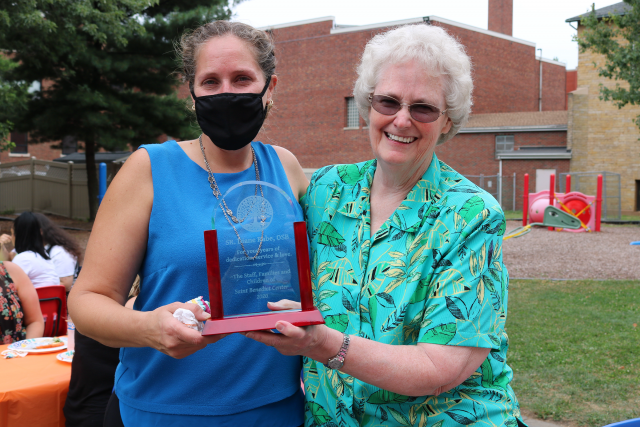 Jill Varner, left, presents Sister Diane with a commemorative plaque