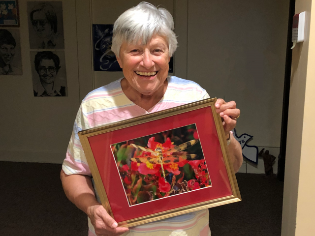 """Sister Lucia Surmik with another of her pieces, """"Realm of Beauty"""""""