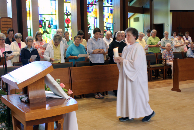 Sister Colette Korn processes into chapel during the Vigil of Sunday in the monastery chapel.