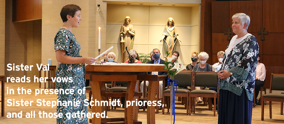 Sister Val reads her vows in the presence of Sister Stephanie Schmidt, prioress,  and all those gathered.