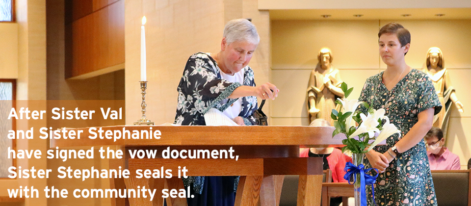 After Sister Val and Sister Stephanie have signed the vow document, Sister Stephanie seals it with the community seal.