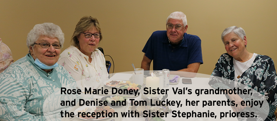 Rose Marie Doney, Sister Val's grandmother, and Denise and Tom Luckey, her parents, enjoy the reception with Sister Stephanie, prioress.