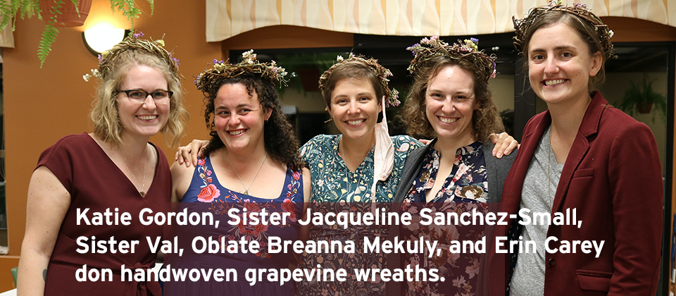 Katie Gordon, Sister Jacqueline Sanchez-Small, Sister Val, Oblate Breanna Mekuly, and Erin Carey  don handwoven grapevine wreaths.