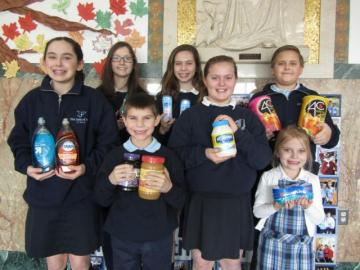 Students from OLP with their donations to Emmaus