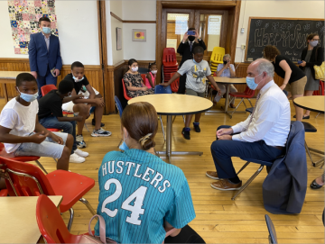 Senator Casey sits down with the Kids Cafe children