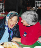 Sister Mary Miller (right) with Emmaus guest.