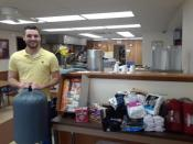 Shaun Choffel from Erie Insurance Westport delivers items gathered during the first week of their two-week Sock Drive for Emmaus.