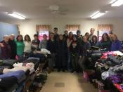 Volunteers on Saturday to receive and sort clothing items.