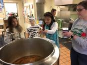Second and third graders at St. Luke's making minestrone soup for Emmaus Soup Kitchen.