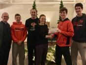 Campus Ministry students and Fr. Jason with Breanna Mekuly of Emmaus.