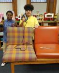Carl and Kareem after upholstering the chairs