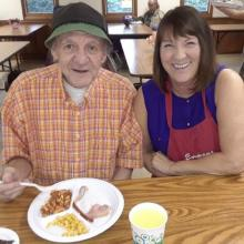 Colleen with a guest at the soup kitchen