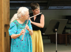 Sister Jean Wolbert and Brittany begin the gathering with music