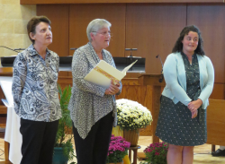 Colleen, Sister Stephanie, Jacqueline move to the front of the chapel for the call and response.