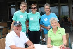 Golfers Dan and Kathy Dahlkemper, seated, with <br />Sisters Linda Romey, Val Luckey, and Sue Doubet