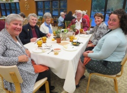 Sister Stephanie, formation team members Sisters Joan Chittister and Chris Kosin, and Sisters Ann, Colleen and Jacqueline in the monastery dining room.