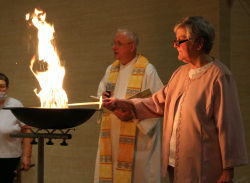 Sister Stephanie Schmidt, Prioress, and Fr. Bob Brugger, bless the new fire at the Easter Vigil..