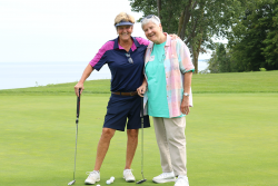 Prioress Stephanie Schmidt gets a crash course in <br />putting from her sister, Maureen Schmidt