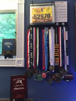 A display of the medals Victor has won in races throughout the area.