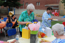Sister Diane opens farewell gifts from families, friends and staff.