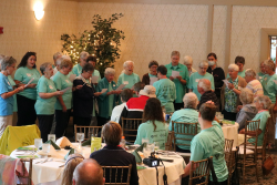 The Benedictine Sisters sing a blessing for the <br />golfers before dinner
